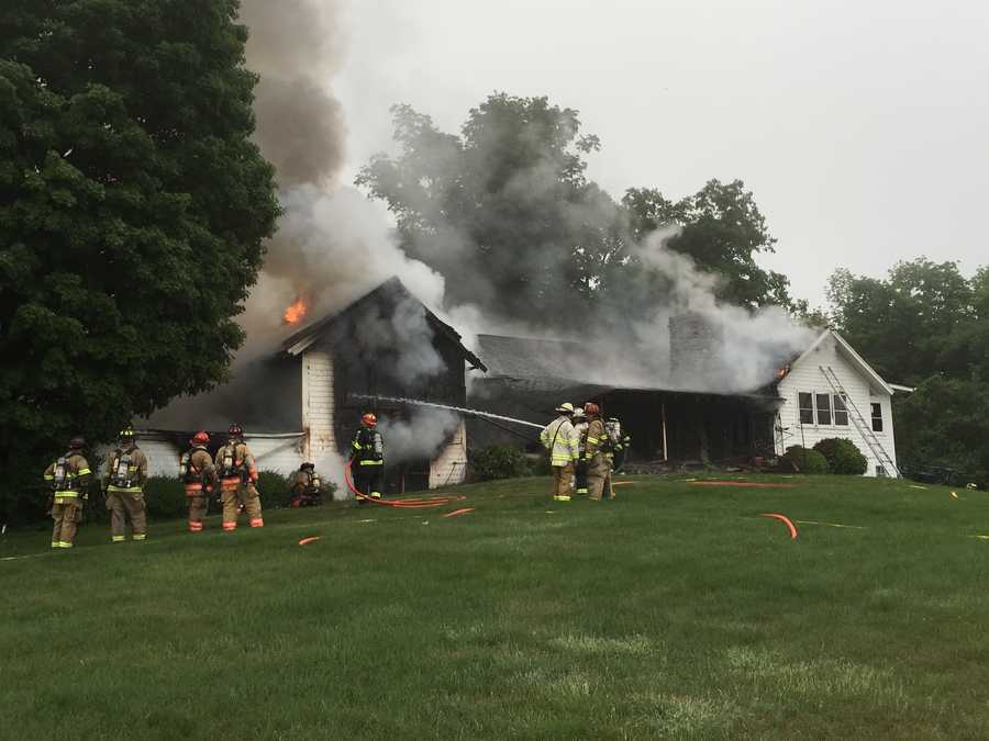 Firefighters battled a four-alarm blaze in Peterborough on Tuesday morning.