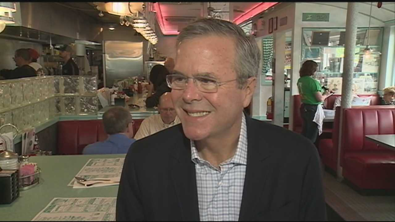 A day after making his candidacy official, former Florida Gov. Jeb Bush headed to New Hampshire, where he held a town hall meeting and made a surprise stop at a diner.