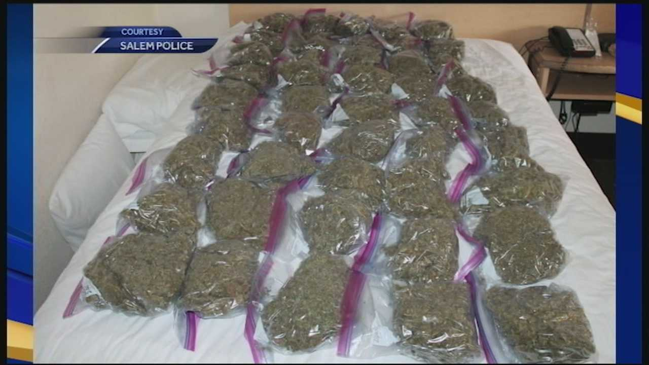 Salem police confiscated pounds of marijuana and stacks of cash from a Salem motel room Tuesday morning.