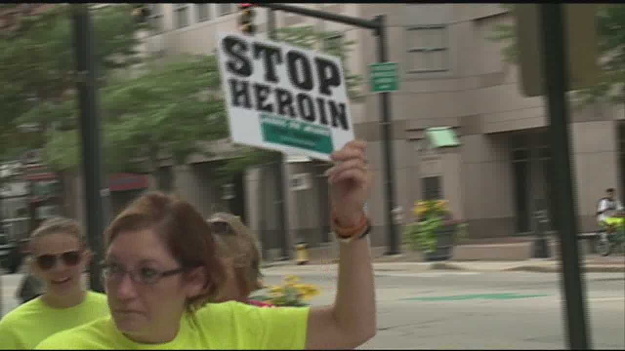 A group in Manchester is taking the fight against heroin to the streets one step at a time.