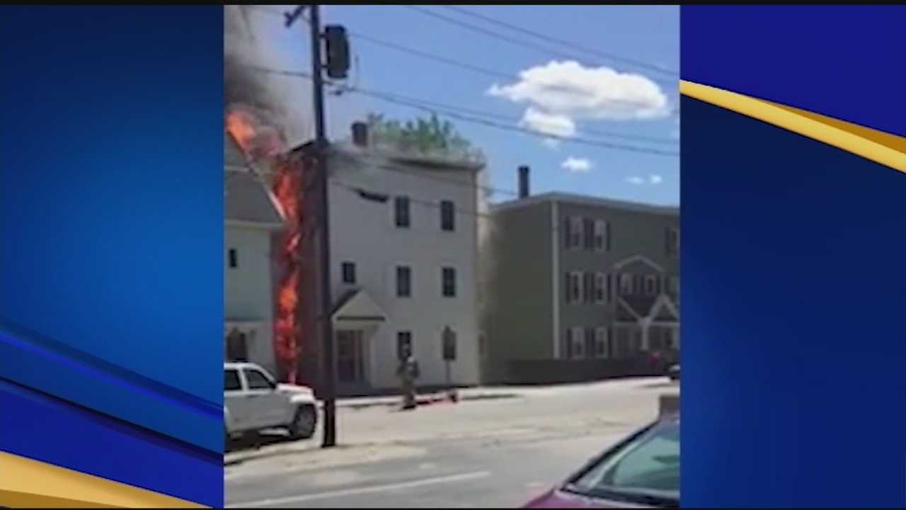 An apartment building fire in Manchester Saturday displaced 17 people, injured four firefighters, and blew up a car.