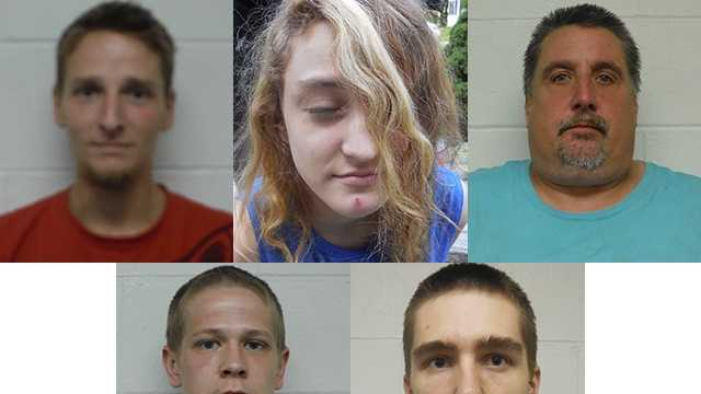 Five people faces charges after police seized heroin and drug paraphernalia from a home in Pembroke on Wednesday.