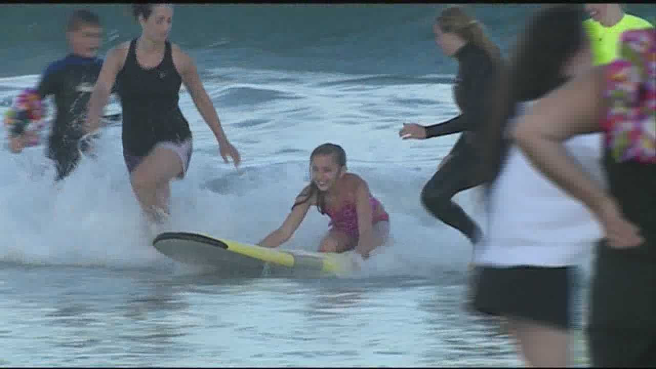 Surfers from all over New England gathered in North Hampton Thursday for Surfing With Smiles -- a free, non-profit program that teaches people with special needs how to catch a wave.