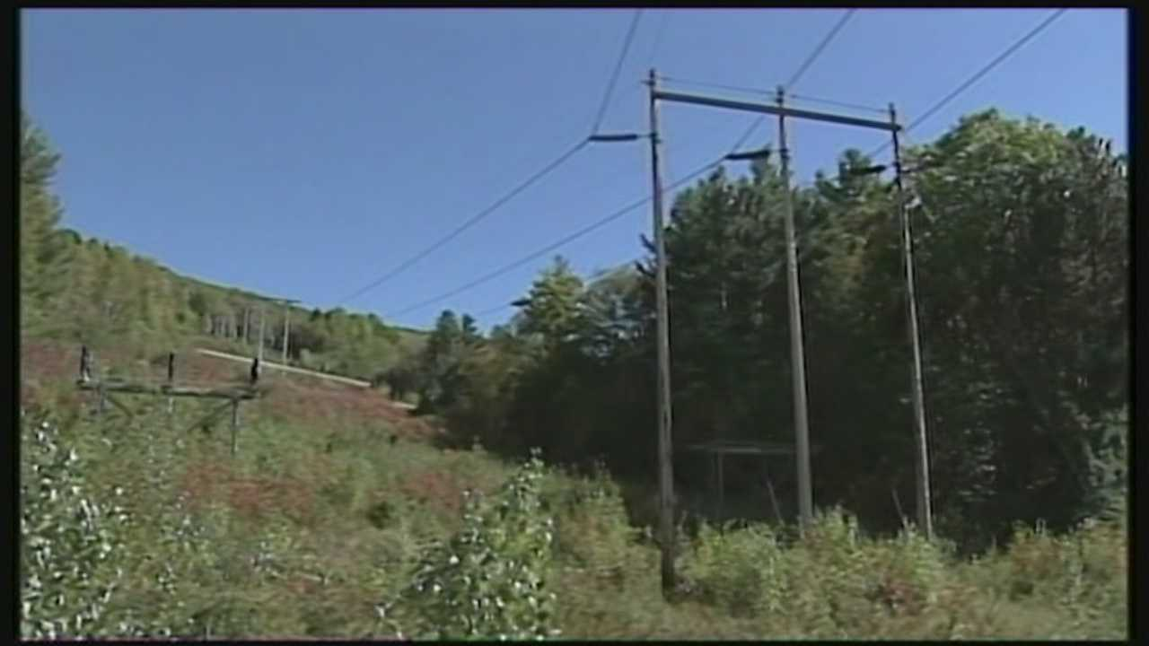 A revised proposal to carry hydropower from Canada through New Hampshire calls for more buried transmission lines, fewer power poles and less juice flowing to consumers.