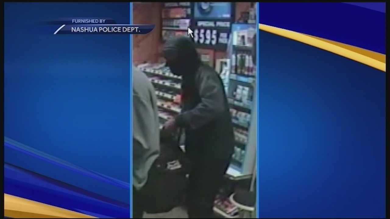 A masked man ordered people to the ground at gunpoint at a Nashua gas station early Wednesday morning, police said.