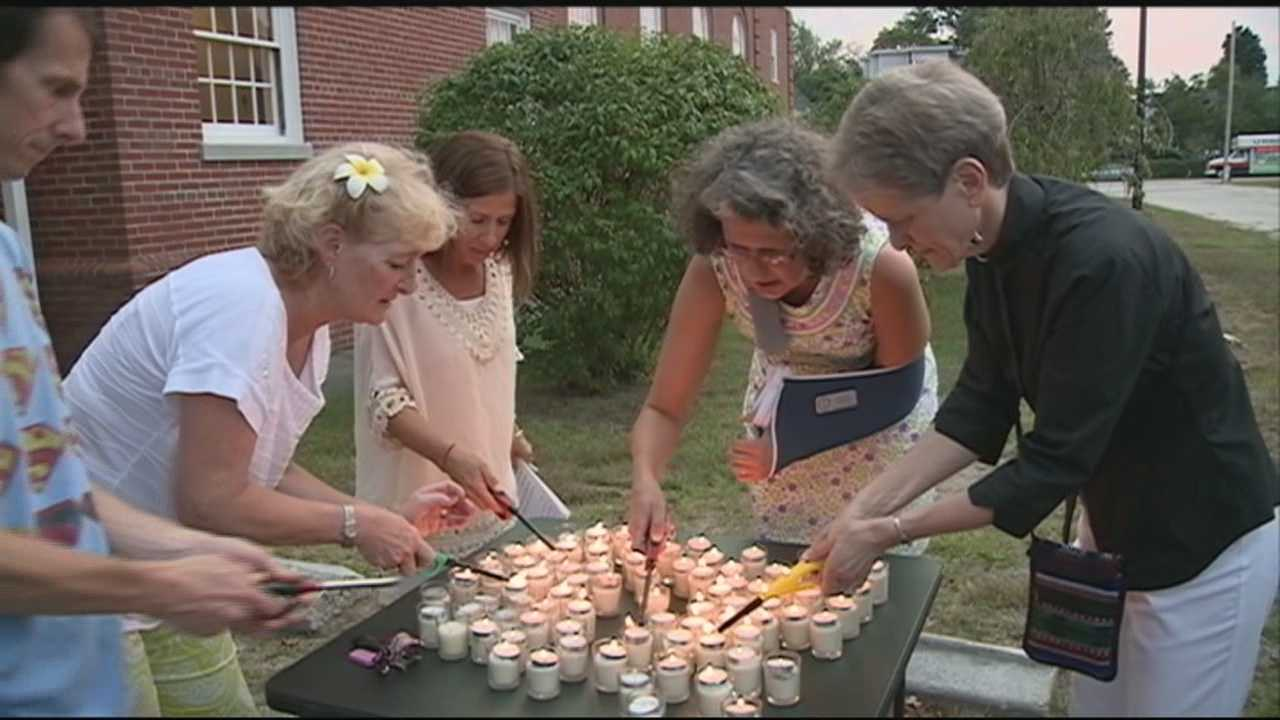 People came together Thursday night for a candlelight vigil walk in Manchester to remember the life of Denise Robert, who was shot and killed while out for a walk in Manchester's north end on Sunday night.