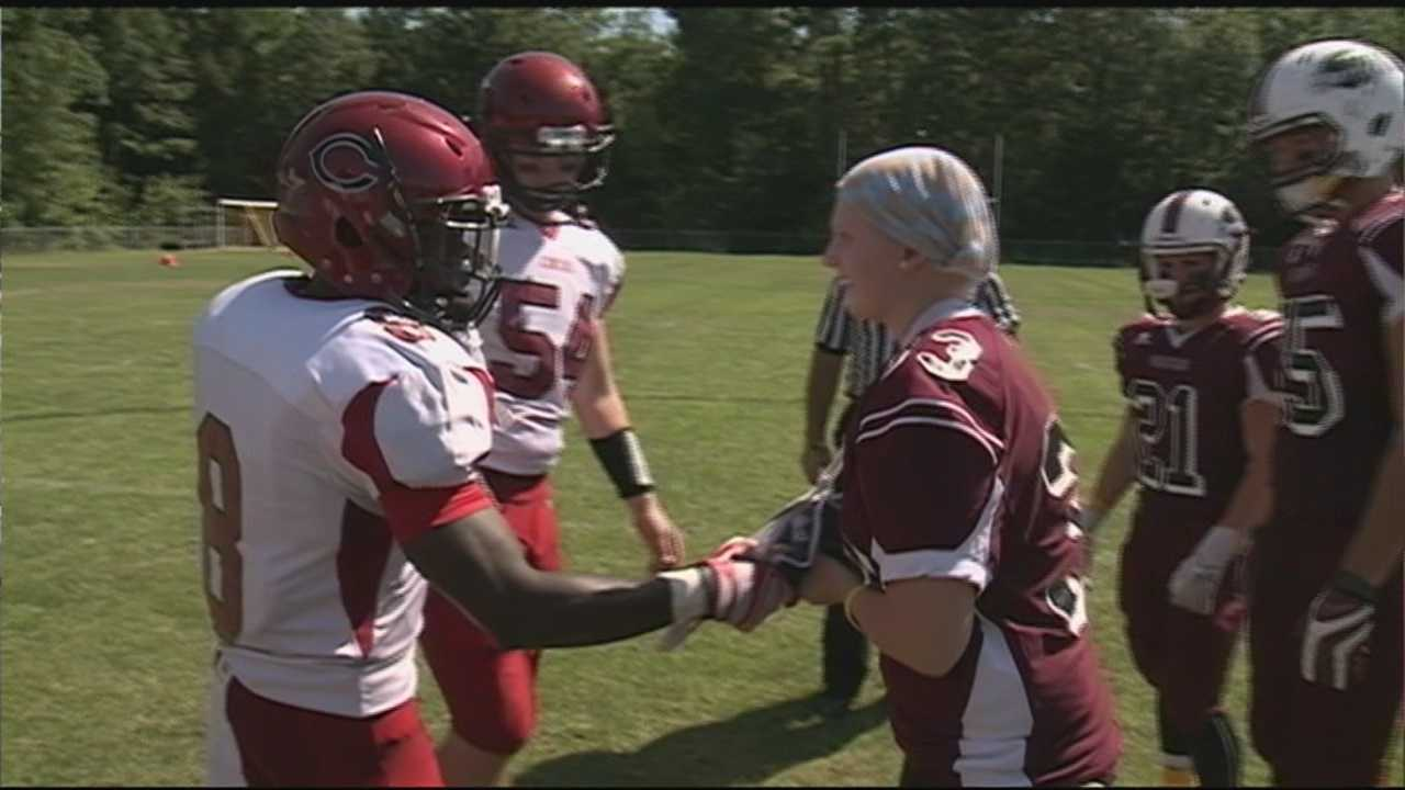 A Goffstown teen fighting her own battle led her high school football team in their first game of the season.