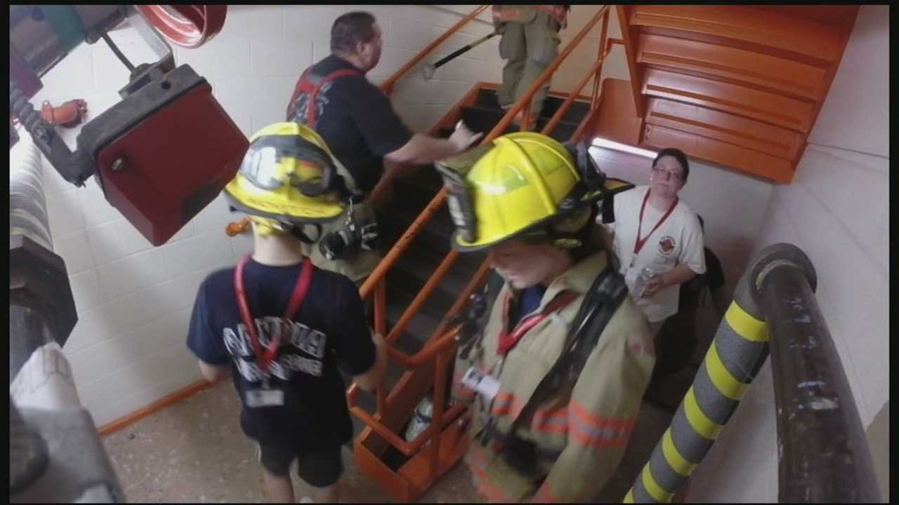 Firefighters and locals climb stairs at Brady Sullivan tower to honor victims of 911.