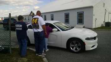 Fans met NASCAR officials while waiting to see their favorite drivers land.