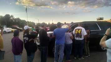 Jamie McMurray stopped to sign autographs for fans.