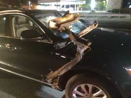 A piece of scrap metal came flying off a truck and smashed right through her windshield