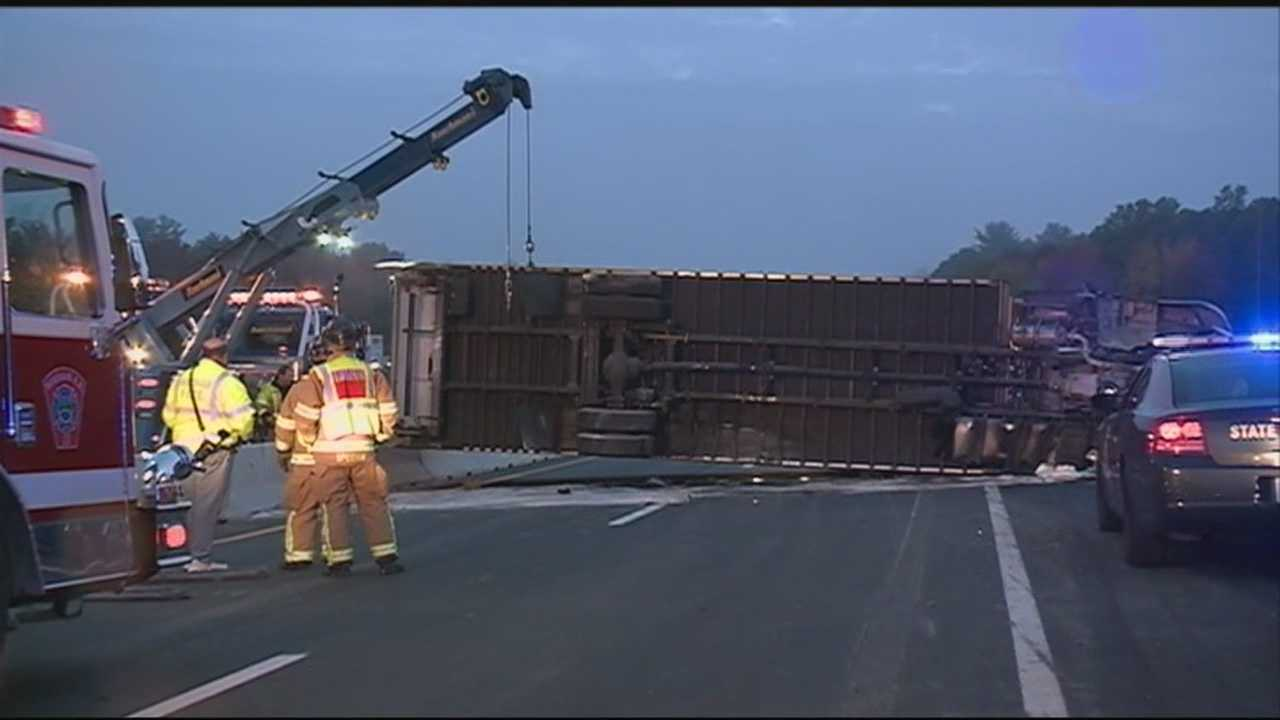 Interstate 93 North was shut down at the peak of morning rush Tuesday when a box truck rolled over.