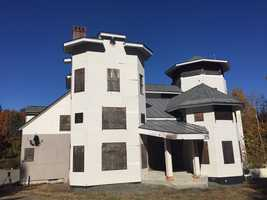 The former home of a New Hampshire couple convicted of tax evasion is up for auction, with the minimum bid set for $125,000.