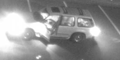 Bedford police are trying to track down two people who were caught on camera vandalizing cars in the high school parking lot.