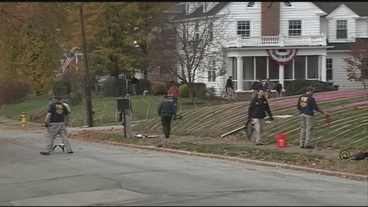 An FBI team Thursday searched the yards of Manchester homes near where a woman was shot and killed two months ago.