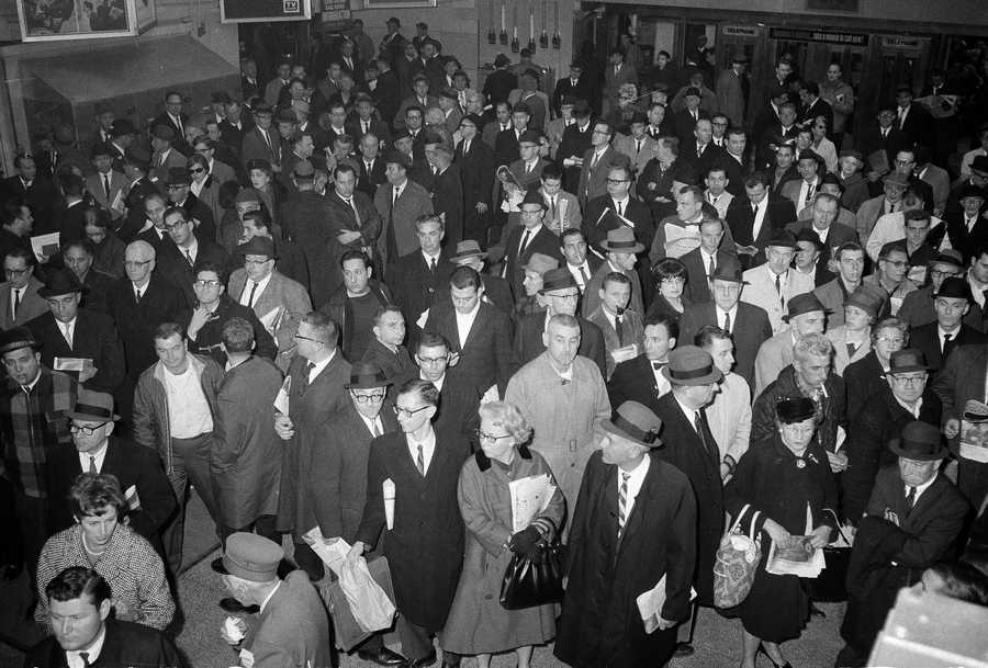 In this Nov. 9, 1965 file photo, stranded commuters crowd the waiting area of the Long Island Railroad in New York's Pennsylvania Station during a massive power failure that plunged tens of millions into darkness across the northeastern U.S. and southern Canada for hours. In New York City, it came at 5:27 p.m., the height of the evening commute, trapping hundreds of thousands of subway riders in their train cars, stranding others in building elevators, and turning Grand Central Terminal into an ad-hoc bedroom for commuters who couldn't get home.
