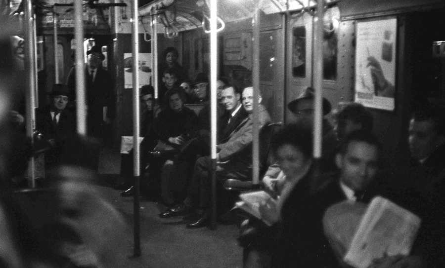 In this Nov. 9, 1965 file photo, passengers sit patiently in near-darkness in a stalled subway car at West 4th Street in the Manhattan section of New York, during the massive power failure that struck at 5:27 p.m., the height of the evening commute. Stretching across the northeastern U.S. and southern Canada, in New York it trapped hundreds of thousands of subway riders in their train cars, stranded others in building elevators, and turned Grand Central Terminal into an ad-hoc bedroom for commuters who couldn't get home.