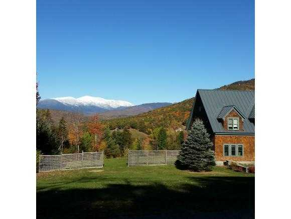 The property boasts breathtaking panoramic views of the White Mountains.