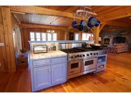 Inside the timber frame home, you'll find an open concept floor plan.