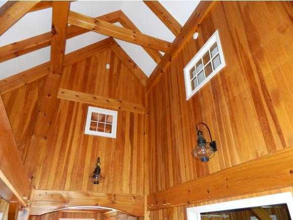 You'll find vaulted cathedral ceilings, along with wood and stonework throughout.
