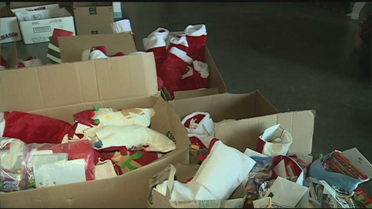 Thousands of holiday stockings were stuffed for troops overseas Friday.