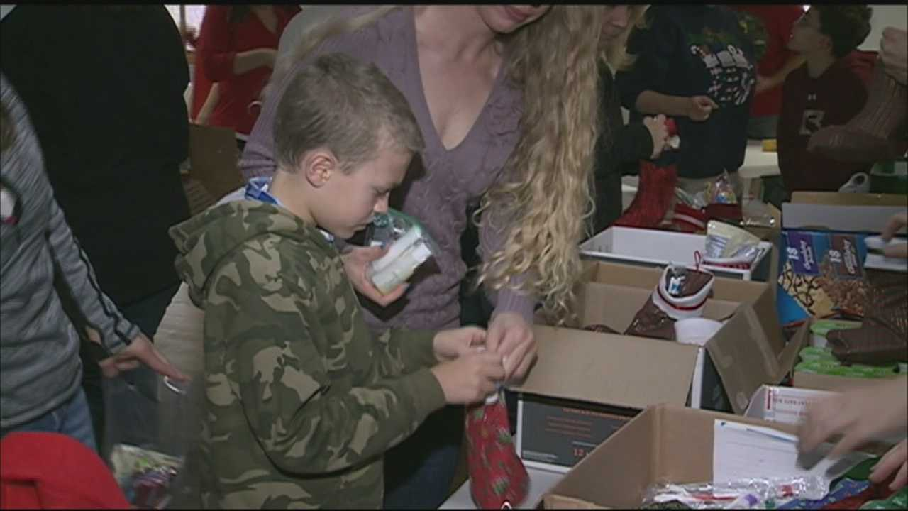 Some of Santa's little helpers created care packages in Epping Sunday for those who serve our country and keep us safe.