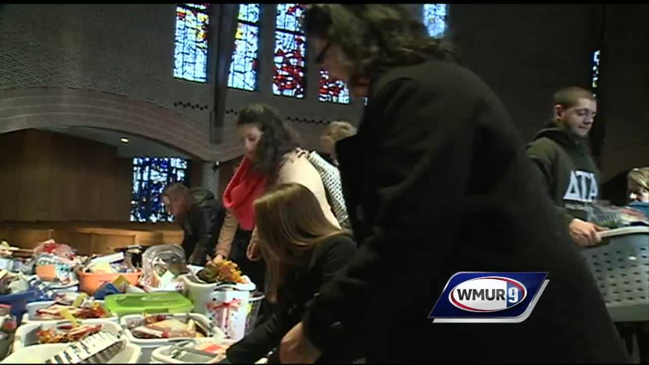 Students at St. Anselm College came together Monday morning for the blessing of 120 food baskets as part of a Thanksgiving tradition that started 13 years ago.