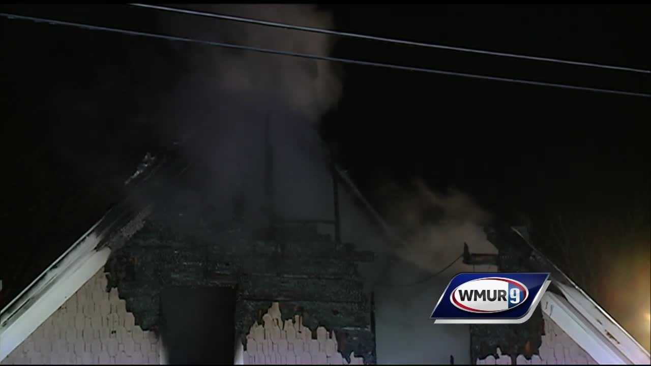A battery of firefighters battled a two-alarm fire on Moran Road in Hopkinton on Monday.
