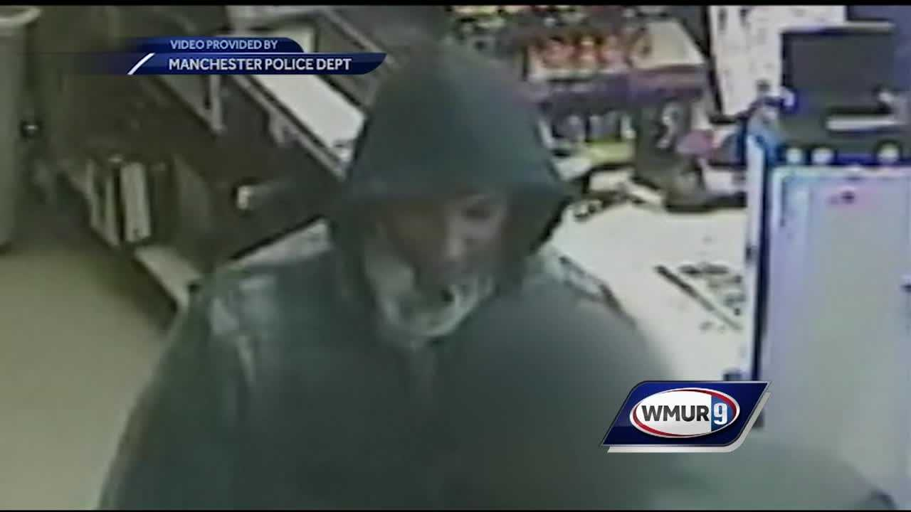 Police in Manchester are searching for an armed robber who fought a clerk to get cash from a register Monday night.