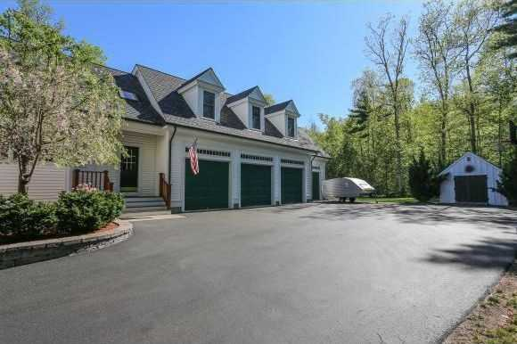 The home has a garage with four bays, one of which has radiant heat and air conditioning, as well as a hot/cold car washing station.