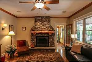 The family room has a gas fireplace with a granite and fieldstone hearth.