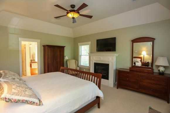 The master bedroom also has a gas fireplace, along with a walk-in closet with a built-in safe.