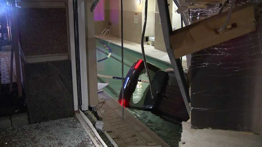 The vehicle went through the building and into the pool.