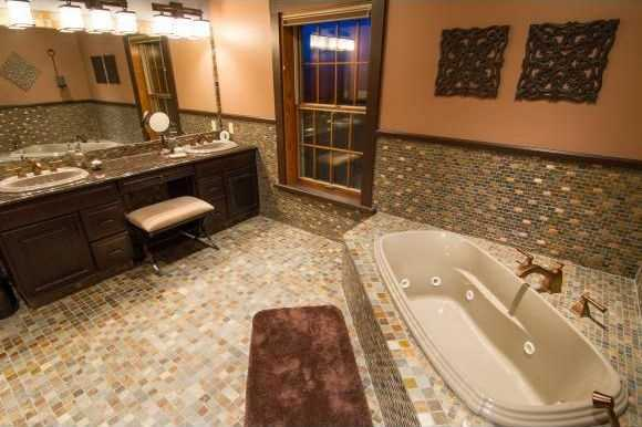 The master bathroom has a Jacuzzi tub and steam shower.