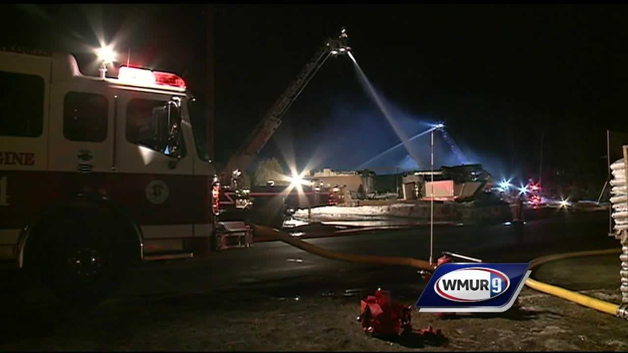 Firefighters battled a two-alarm blaze at a Dunkin' Donuts in Tilton early Wednesday morning.