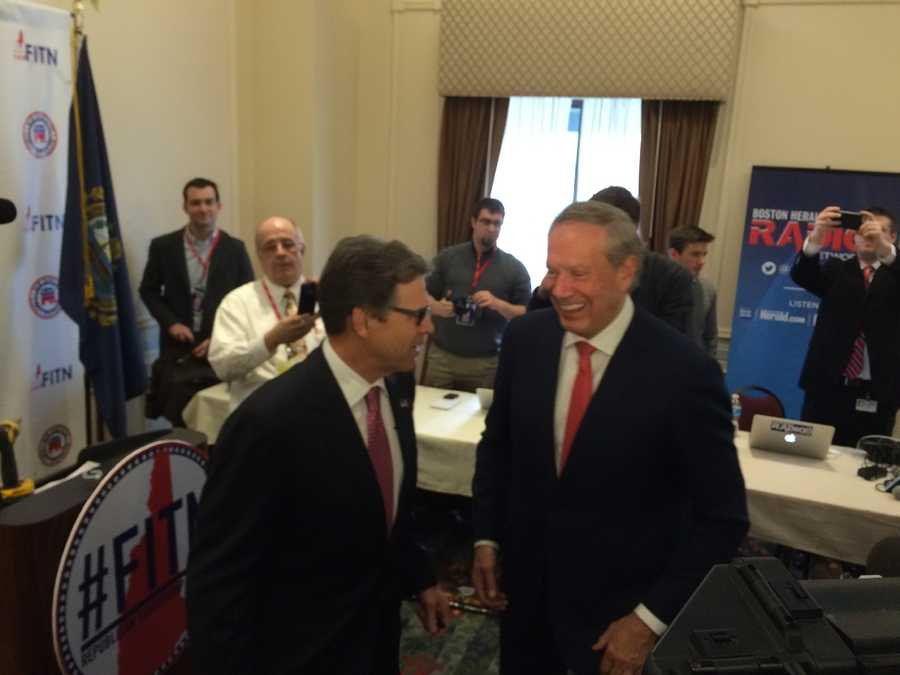 Governors Rick Perry and George Pataki share a laugh at the NHGOP Summit in Nashua on April 17, 2015.