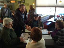 Gov. Mike Huckabee greets diners at the North Side Grille in Hudson on April 18, 2015.
