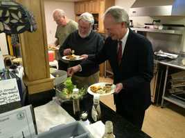 Sen. Lincoln Chafee grabs a bite to eat at a joint meeting of the Milford and Amherst Democratic Committees in Milford on May 6, 2015.