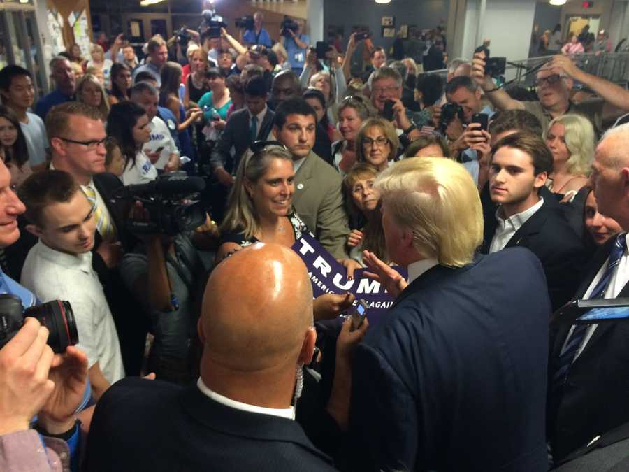 Donald Trump faces down a mob of reporters and fans after launching his New Hampshire campaign at Manchester Community College in Manchester on June 17, 2015.