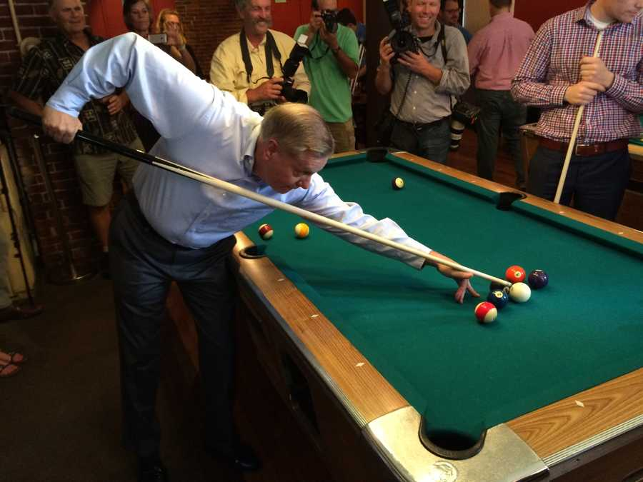 Sen. Lindsey Graham shoots pool at Milly's Tavern in Manchester on July 10, 2015.