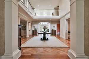 The interior featuresdetailed living areas, a gourmet kitchen and guest quarters.