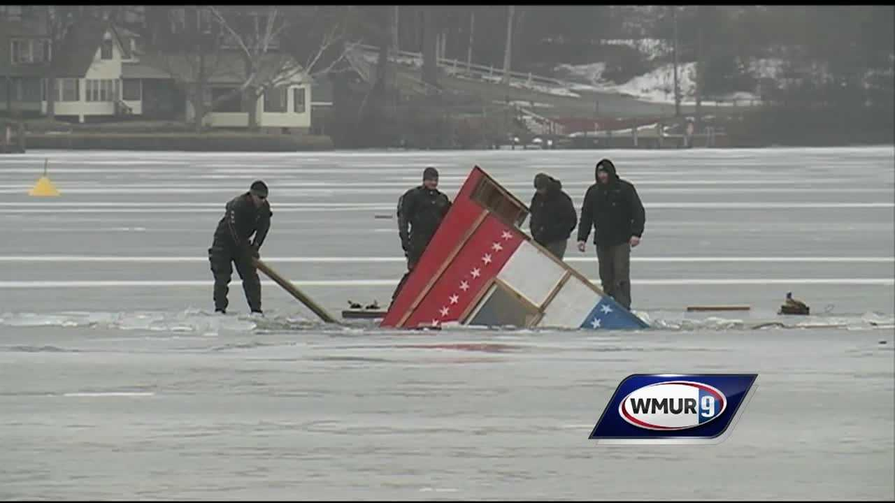 Crews worked to pull a bobhouse out of Alton Bay on Wednesday after it broke through ice weakened by this year's warm winter.