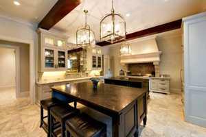 This kitchen has three sub-zero refrigerators/freezer, three Miele dishwashers, two islands and a breakfast nook.