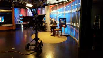 Andy Smith sits on set during Primary coverage.