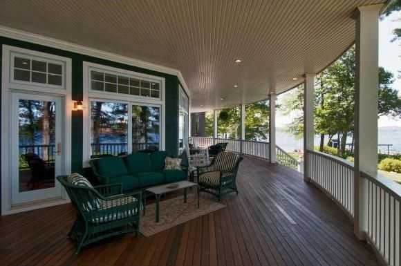 Outside, there is a covered porch, a screened area and a wrap-around balcony.