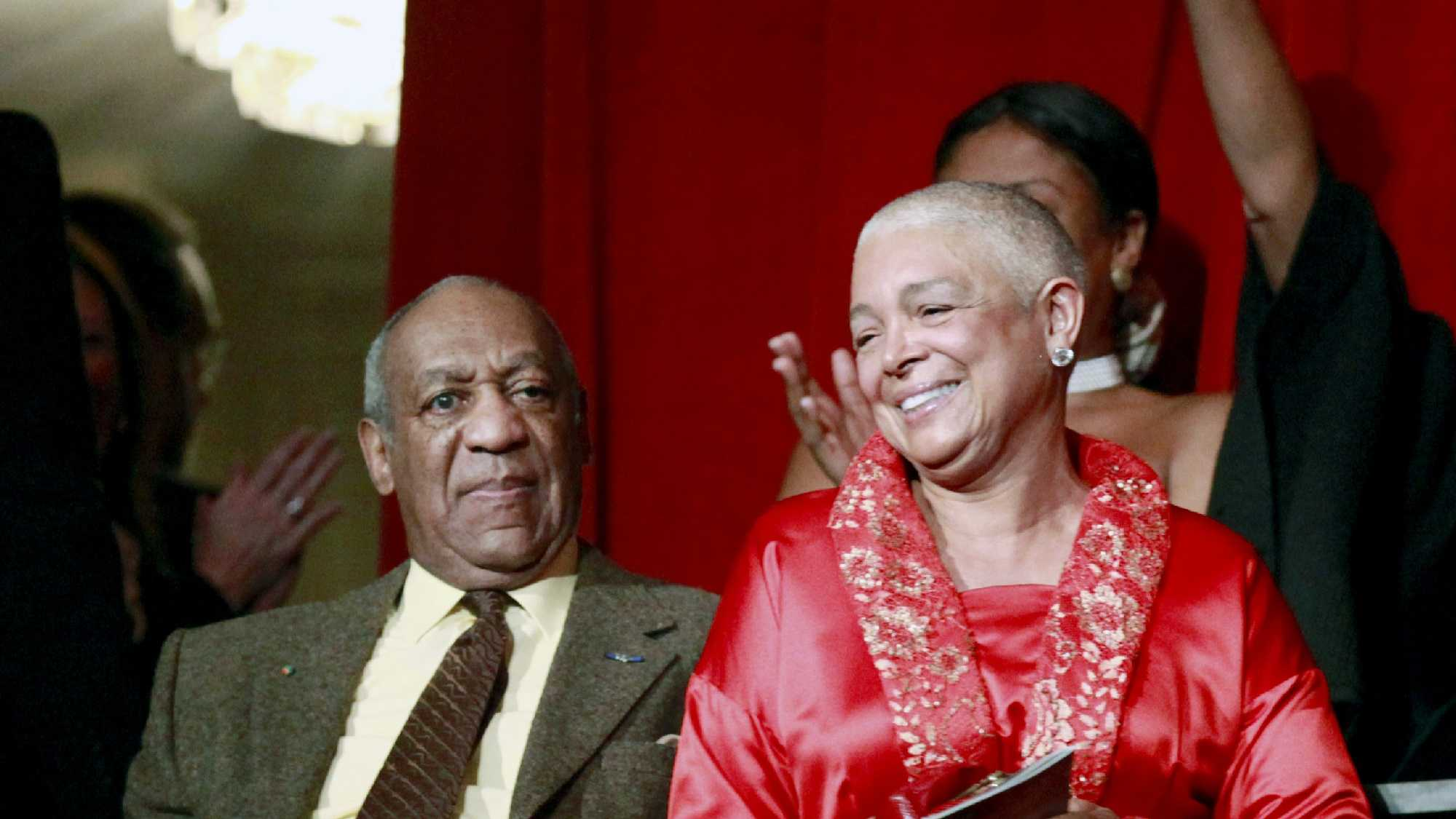 This Oct. 26, 2009 file photo, comedian Bill Cosby, left, and his wife Camille appear at the John F. Kennedy Center for Performing Arts before Bill Cosby received the Mark Twain Prize for American Humor in Washington.