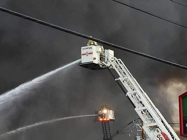Smoke could be seen in downtown Manchester and by drivers on Interstate 293.