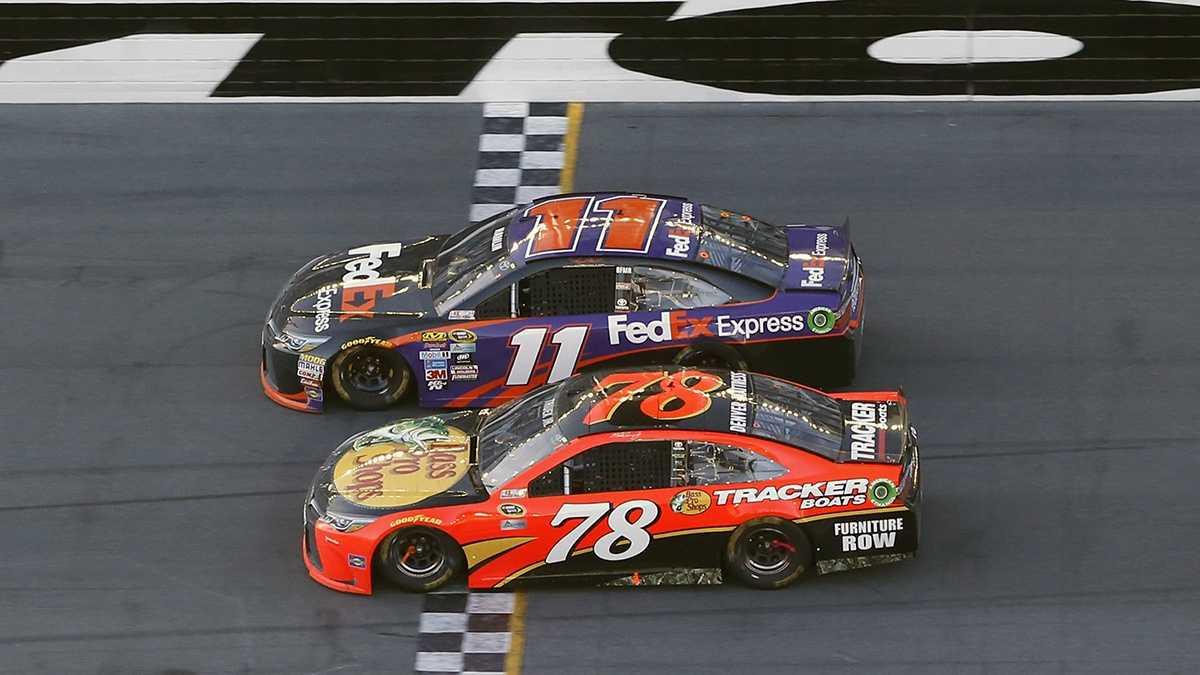 Denny Hamlin (11) beats out Martin Truex Jr. (78) at the finish line to win the NASCAR Daytona 500 auto race at Daytona International Speedway, Sunday, Feb. 21, 2016, in Daytona Beach, Florida.