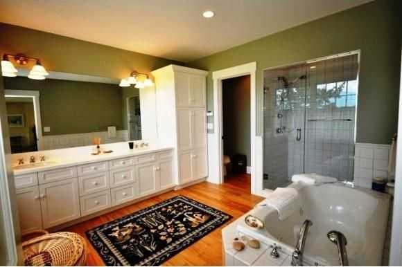 The master en-suite is large and beautifully constructed featuring dual sinks, a large tub, and a standing shower.