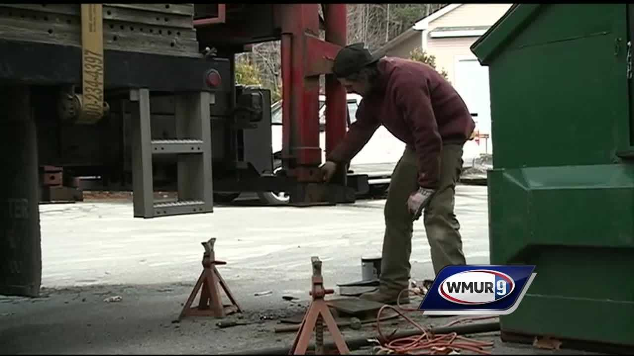 New Hampshire officials say the state's unemployment rate dipped below 3 percent in January, the lowest it's been since 2001.